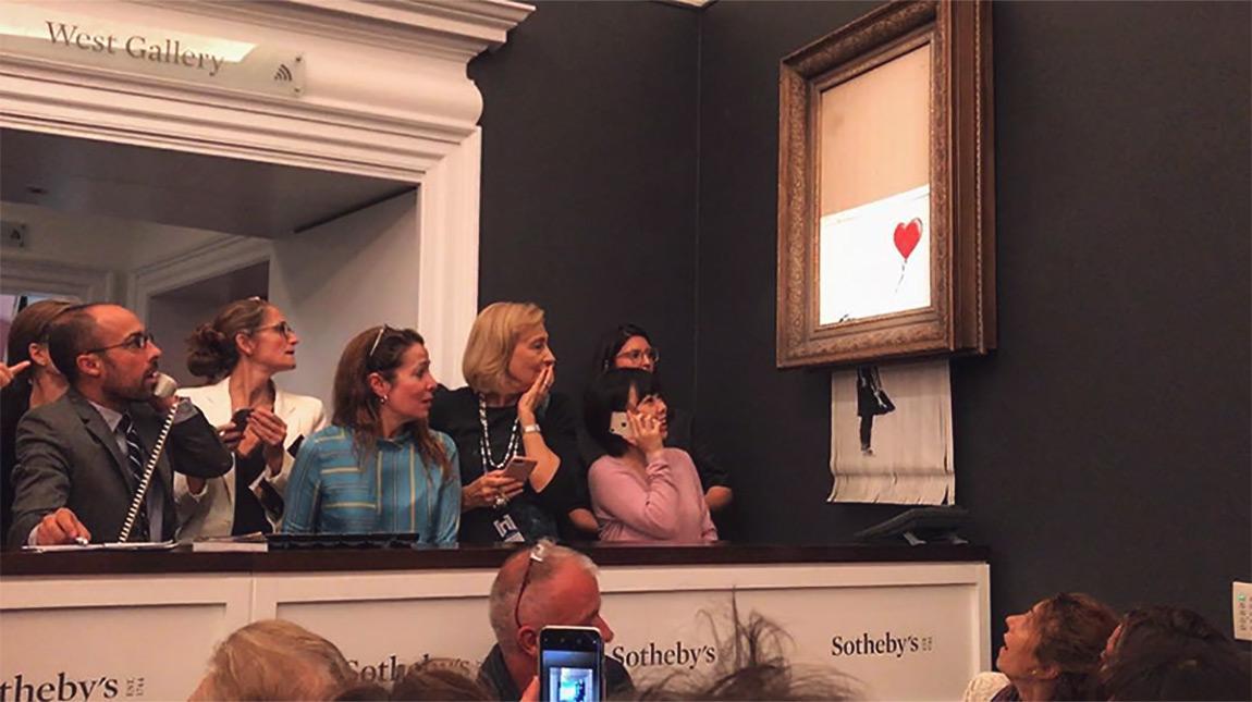 قصة لوحة بانكسي التي تمزقت ذاتياً بعد بيعها بـ 1.4 مليون دولار